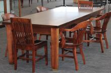 Conference table with chairs around it.