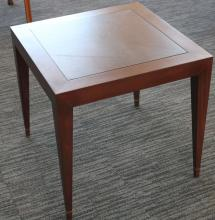 End table on a gray carpet.