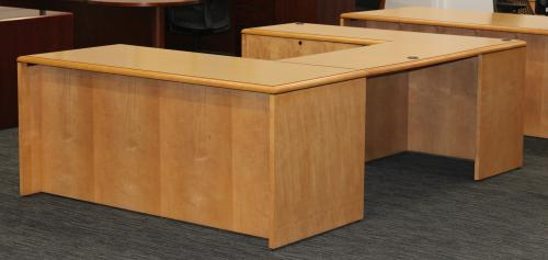 Image of a wooden U-shaped desk.